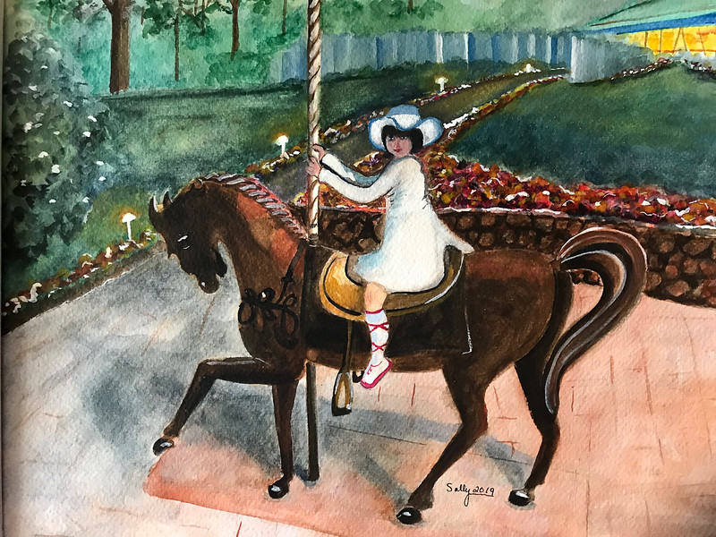 Girl on Merry-Go-Round Horse