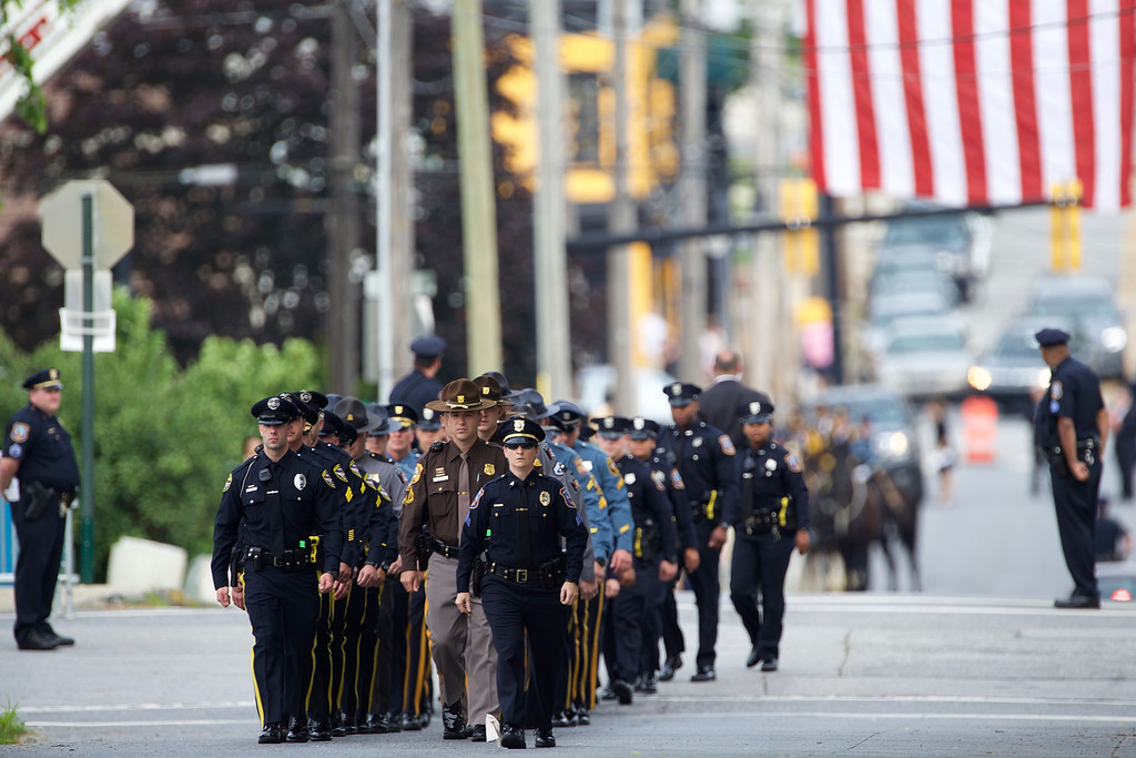 . A funeral procession marches towards a mass of Christian burial at St. Anthony of Padua Church for former Delaware Attorney General Beau Biden on June 6, 2015 in Wilmington, Delaware. U.S. President Barack Obama delivered a eulogy for the son of Vice President Joe Biden after he died at 46 following a two-year battle with brain cancer.  (Photo by Mark Makela/Getty Images)