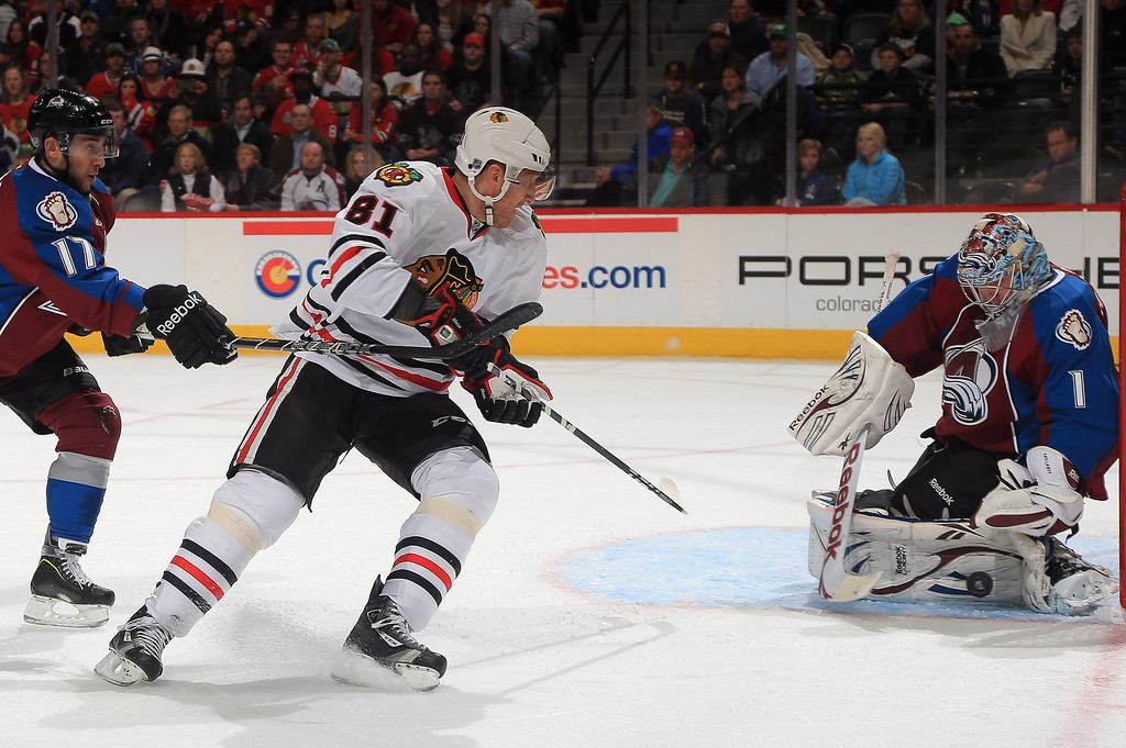 . Goalie Semyon Varlamov #1 of the Colorado Avalanche blocks a shot by Marian Hossa #81 of the Chicago Blackhawks at the Pepsi Center on March 18, 2013 in Denver, Colorado.  (Photo by Doug Pensinger/Getty Images)