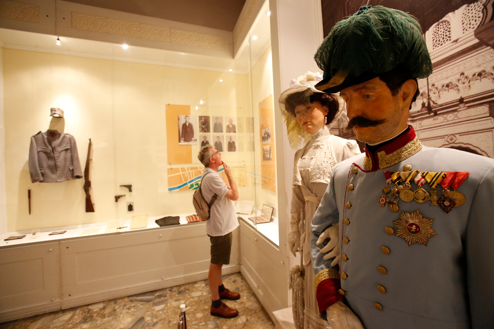 . Tourists look at exhibits in Sarajevo museum, including life-size wax figures of Archduke Franz Ferdinand and Sofia von Hochenberg, in Sarejevo, Saturday, June 28, 2014. Saturday marks a century since the assassination of the heir to the Austro-Hungarian throne, Archduke Franz Ferdinand and his wife Sofia von Hochenberg by Serb nationalist Gavrilo Princip, on June 28, 1914. The assassination was the event that ignited the start of World War One. (AP Photo/Amel Emric)