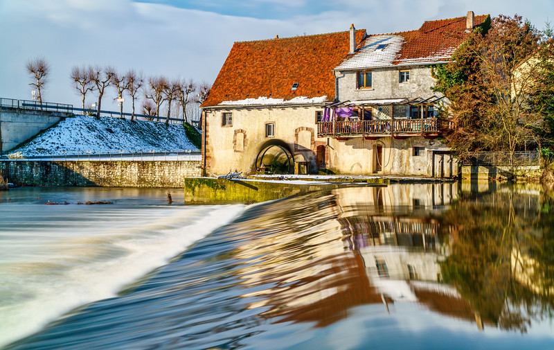 Amazing reflection around the Moulin de Sarreinsming beautified by enchanting winter light.
