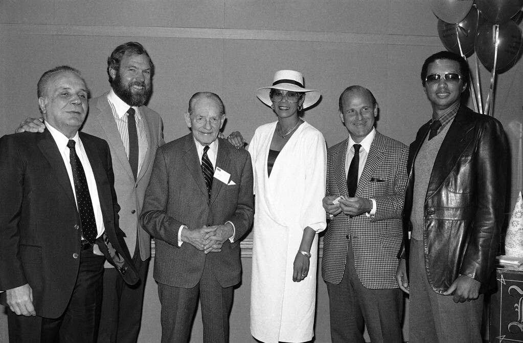 """. Five of America\'s greatest athletes join HBO host Merlin Olsen, second left, before a screening of HBO\'s Sports Special, \""""Champions of American Sports Special\"""", in New York, May 11, 1983. The champions are, from left: Jake LaMotta - boxing, Waite Hoyte - baseball, Wilma Rudolph - track, Dick Button - skating and Arthur Ashe - tennis. (AP Photo/Dave Pickoff)"""