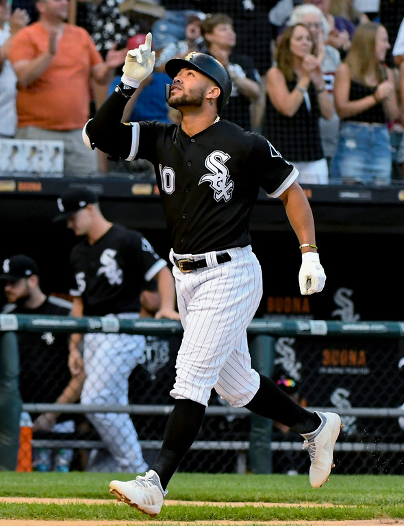 . Chicago White Sox second baseman Yoan Moncada (10) reacts after hitting a home run during the third inning of the team\'s Cleveland Indians on Saturday, Aug. 11, 2018, in Chicago. (AP Photo/Matt Marton)