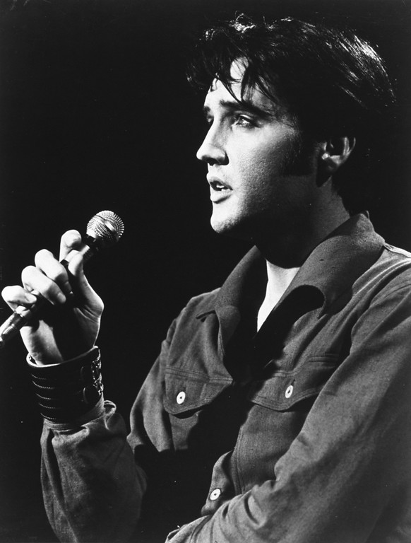 . Elvis Presley sings at a concert in 1958, venue unknown.  (AP Photo)