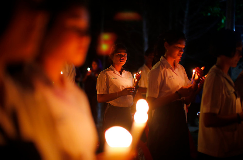 . Thai schoolgirls hold candles as they observe a moment of silence for victims of the Asian tsunami during a commemoration service to mark the 10th anniversary of the day this natural disaster, Friday, Dec. 26, 2014 in Ban Nam Khem, Thailand. Dec. 26 marks the 10th anniversary of one of the deadliest natural disasters in world history: a tsunami, triggered by a massive earthquake off the Indonesian coast, that left more than 230,000 people dead in 14 countries and caused about $10 billion in damage. (AP Photo/Wong Maye-E)