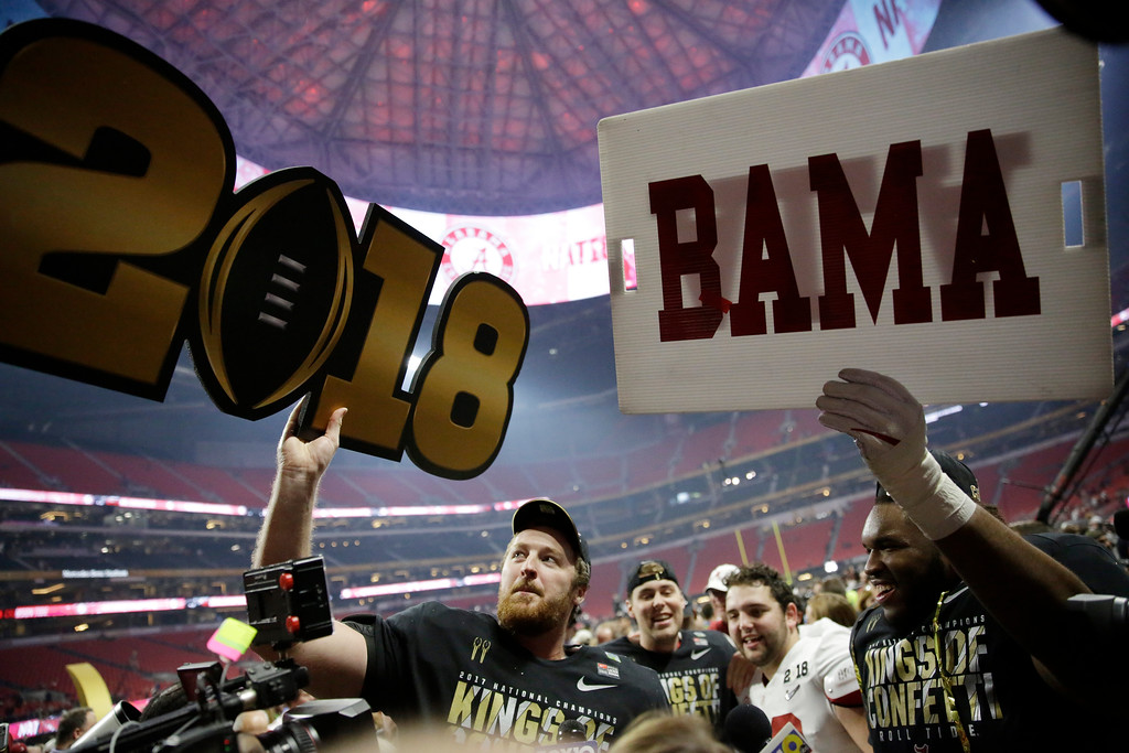 . Alabama players celebrate after overtime of the NCAA college football playoff championship game against Georgia Monday, Jan. 8, 2018, in Atlanta. Alabama won 26-23. (AP Photo/David Goldman)