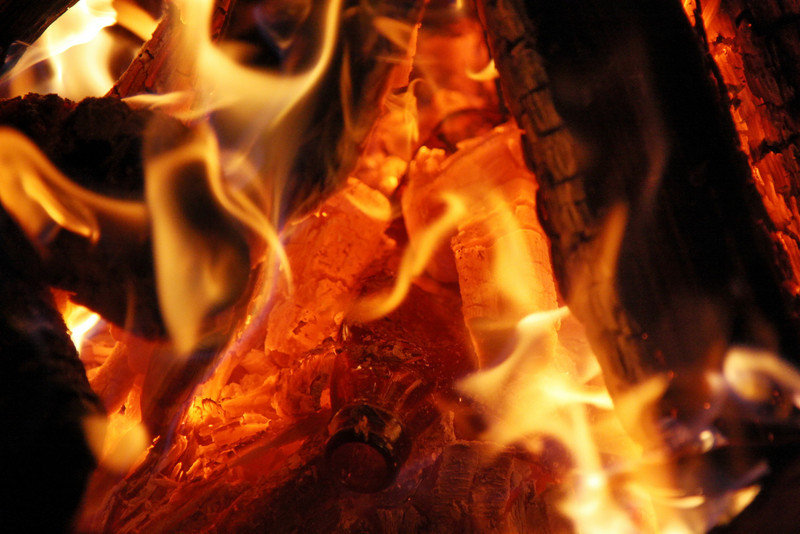 Melting glass in the fire.