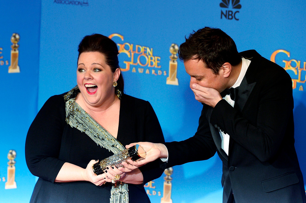 . US actress Melissa McCarthy (L) and comedian Jimmy Fallon (R) joke around in the press room at the 71st Annual Golden Globe Awards at the Beverly Hilton, in Beverly Hills, California, USA, 12 January 2014.  EPA/PAUL BUCK