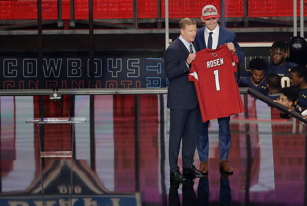 . Commissioner Roger Goodell, left, presents UCLA\'s Josh Rosen with his Arizona Cardinals jersey during the first round of the NFL football draft, Thursday, April 26, 2018, in Arlington, Texas. (AP Photo/Eric Gay)