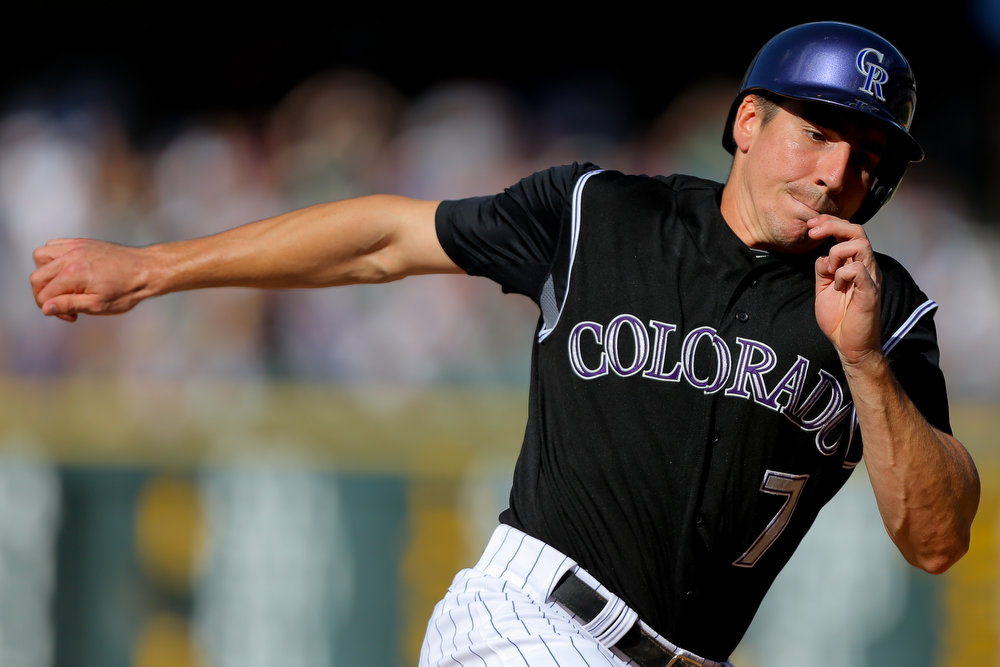 . Matt McBride #7 of the Colorado Rockies rounds third base on his way to scoring during the seventh inning against the Miami Marlins at Coors Field on August 24, 2014 in Denver, Colorado. The Rockies defeated the Marlins 7-4. (Photo by Justin Edmonds/Getty Images)