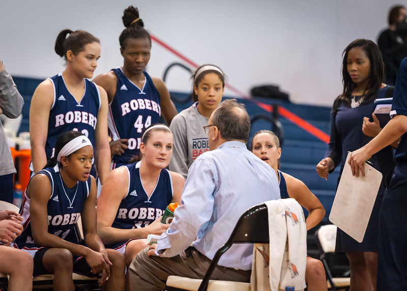 Robert Morris head coach Sal Buscaglia and his players during a timeout.