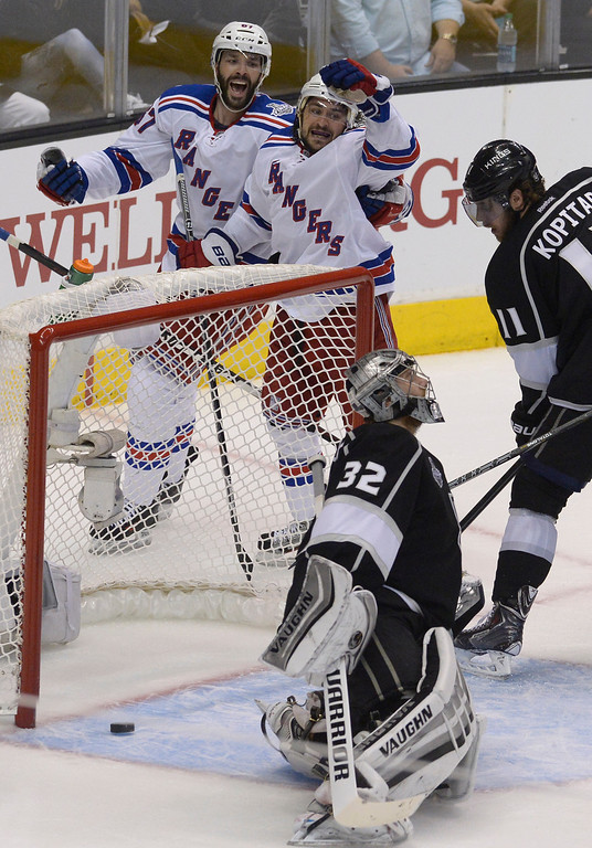 . Rangers#67 Benoit Pouliot celebrates with Rangers#36 Mats Zuccarello after Zuccarello scored a goal in the first period. The Los Angeles Kings faced the New York Rangers in game 2 of the Stanley Cup Final.  Los Angeles, CA. 6/7/2014(Photo by John McCoy Daily News)
