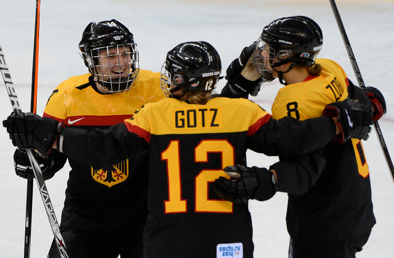 . Germany\'s Susann Goetz (C) celebrates with her teammates after scoring a goal during the Women\'s Ice Hockey 5th-8th place classifications match between Germany and Japan at the Shayba Arena during the Sochi Winter Olympics on February 18, 2014. Germany won 3-2. (JONATHAN NACKSTRAND/AFP/Getty Images)