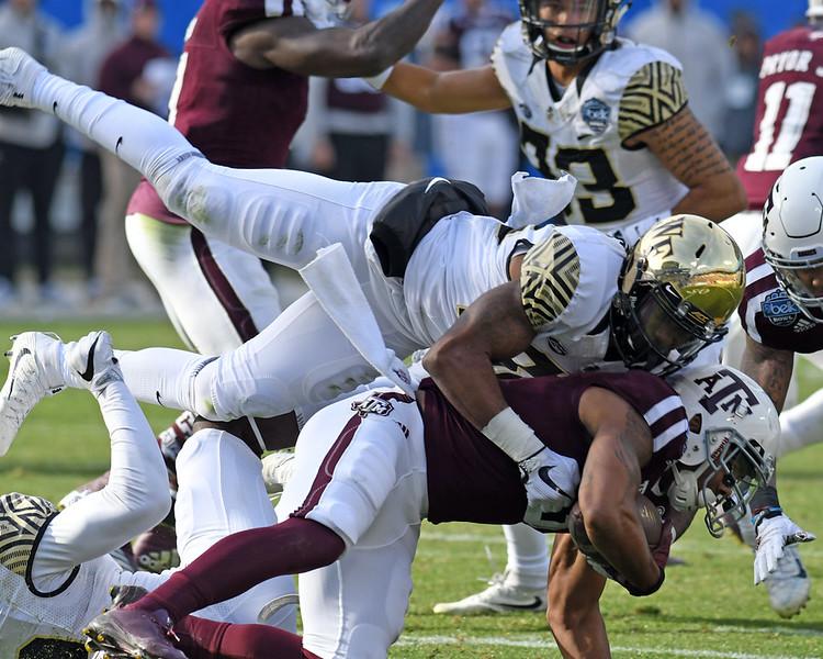 Deacon defender makes tackle on KO.jpg