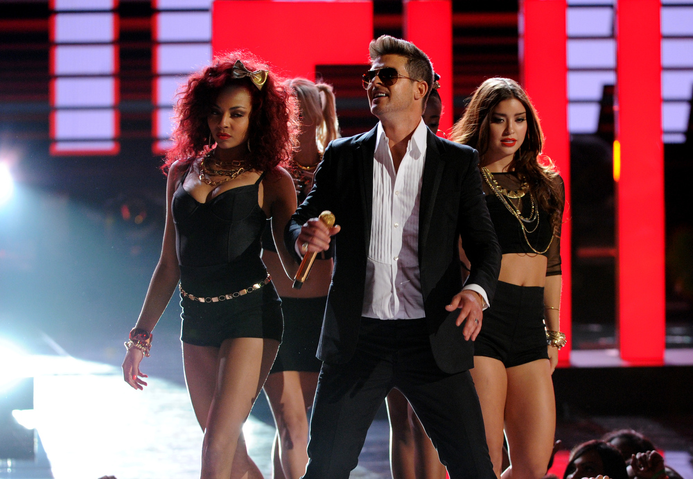 Description of . Robin Thicke performs onstage at the BET Awards at the Nokia Theatre on Sunday, June 30, 2013, in Los Angeles. (Photo by Frank Micelotta/Invision/AP)