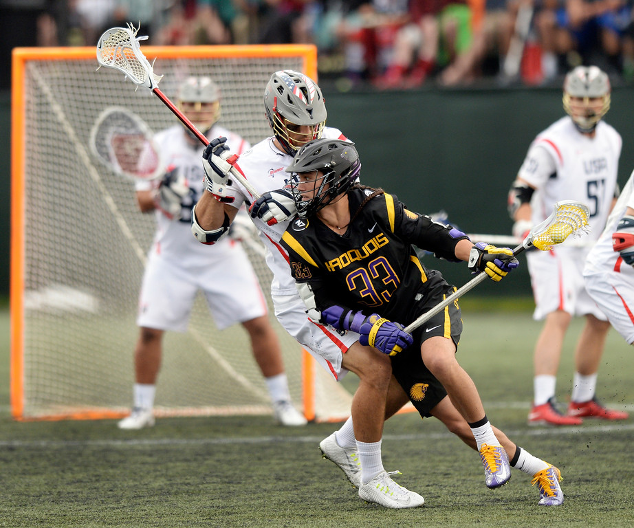 . Iroquois midfielder Zach Miller (33) looked for a way past US midfielder Paul Rabil (99) in the first half.    Photo by Karl Gehring/The Denver Post