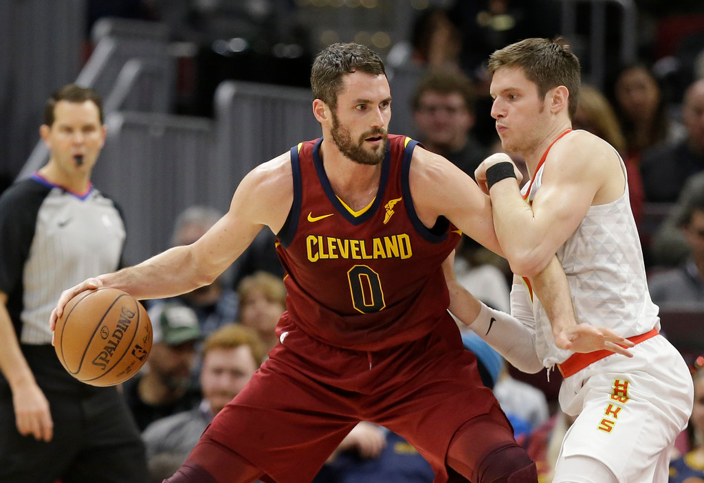 . Cleveland Cavaliers\' Kevin Love (0) drives against Atlanta Hawks\' Luke Babbitt (8) in the first half of an NBA basketball game, Tuesday, Dec. 12, 2017, in Cleveland. (AP Photo/Tony Dejak)