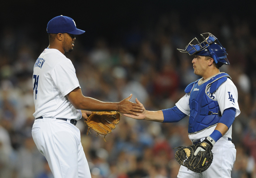 . Dodgers reliever Kenley Jansen is congratulated by Tim Federowicz after closing down the Red Sox, Friday, August 23, 2013. (Michael Owen Baker/L.A. Daily News)