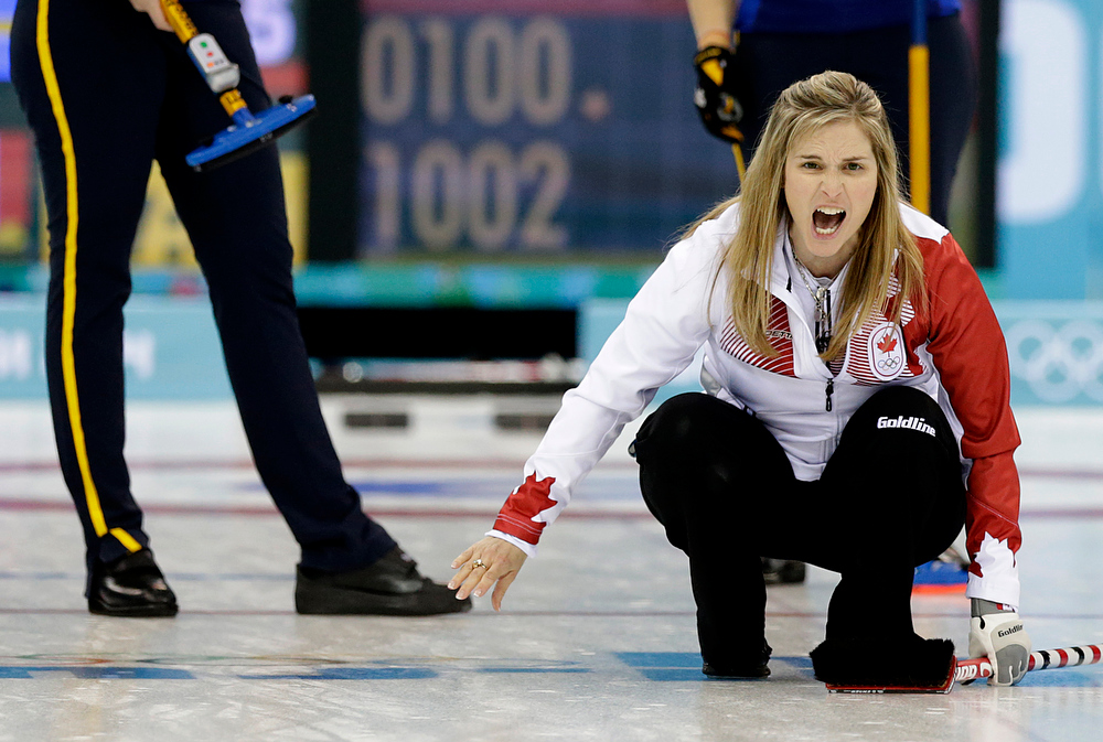 . Canada\'s Jennifer Jones shouts instructions to her teammates during the women\'s curling gold medal game against Sweden at the 2014 Winter Olympics, Thursday, Feb. 20, 2014, in Sochi, Russia. (AP Photo/Wong Maye-E)
