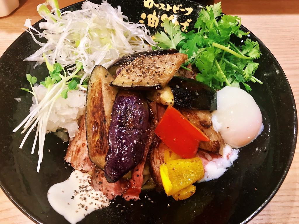 Abura soba with 90g of beef, a soft-boiled egg, grilled aubergine, Japanese leeks, and coriander.