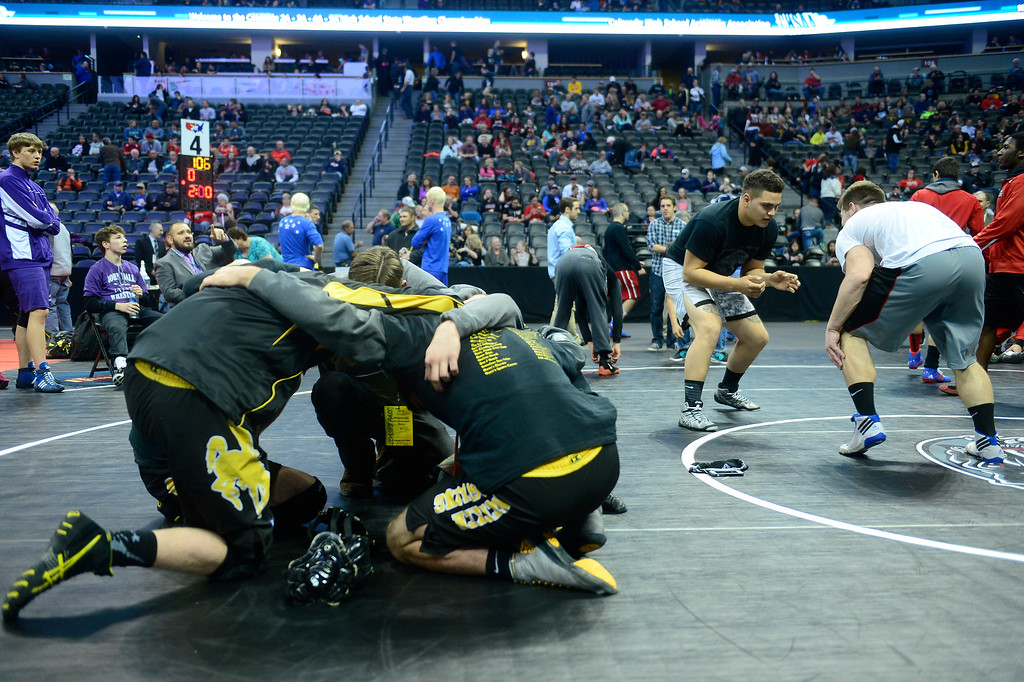 . Meeker High School wrestlers take a knee before the start of the Parade of Champions during the finals of the 2016 Colorado Wrestling State Championships at the Pepsi Center on February 20, 2016 in Denver, Colorado. (Photo by Brent Lewis/The Denver Post)
