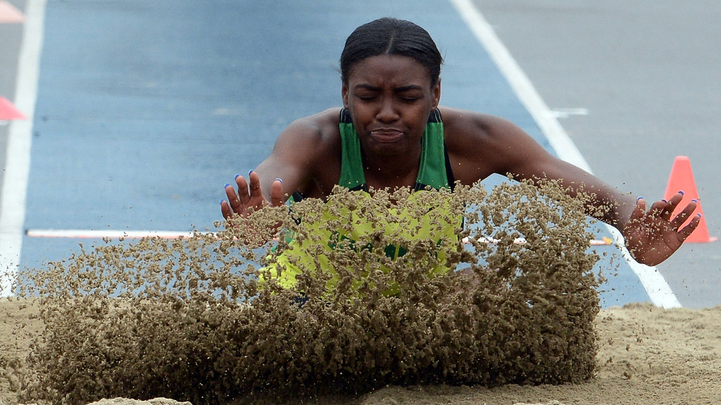 . Long Beach Poly\'s Zhane Smith competes in the division 1 long jump during the CIF Southern Section track and final Championships at Cerritos College in Norwalk, Calif., on Saturday, May 24, 2014.   (Keith Birmingham/Pasadena Star-News)