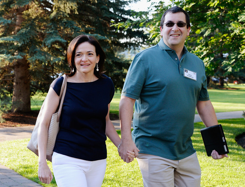 . Sheryl Sandberg, COO of Facebook, and her husband David Goldberg arrive for morning session of the Allen & Co. annual conference at the Sun Valley Resort on July 10, 2013 in Sun Valley, Idaho. The resort is hosting corporate leaders for the 31st annual Allen & Co. media and technology conference where some of the wealthiest and most powerful executives in media, finance, politics and tech gather for weeklong meetings. Past attendees included Warren Buffett, Bill Gates and Mark Zuckerberg.  (Photo by Kevork Djansezian/Getty Images)