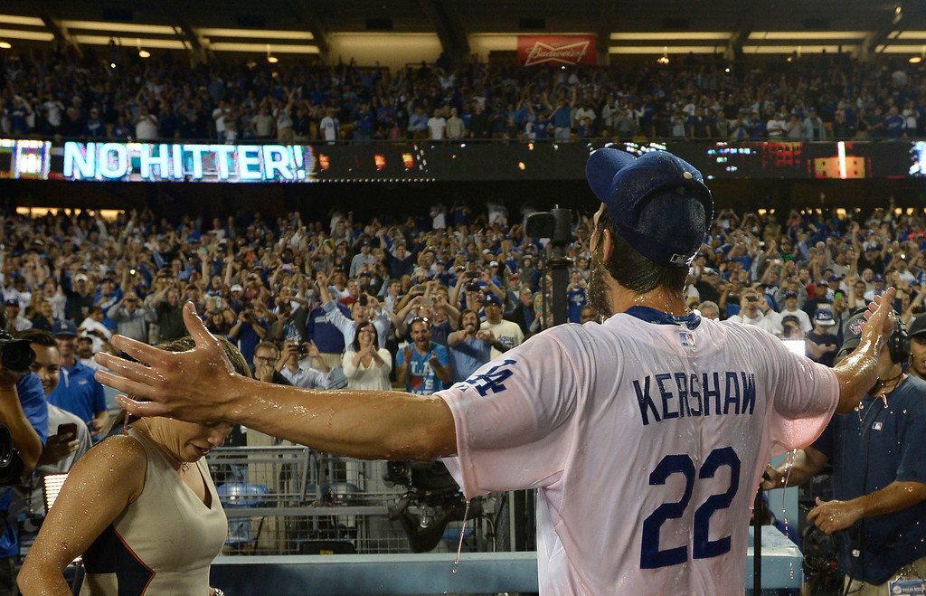 . Clayton Kershaw raises his arms to the stands after being having sports drink dumped on him. Kershaw threw a no hitter. The Dodgers defeated the Colorado Rockies 8-0 at Dodger Stadium in Los Angeles, CA. 6/18/2014(Photo by John McCoy Daily News)