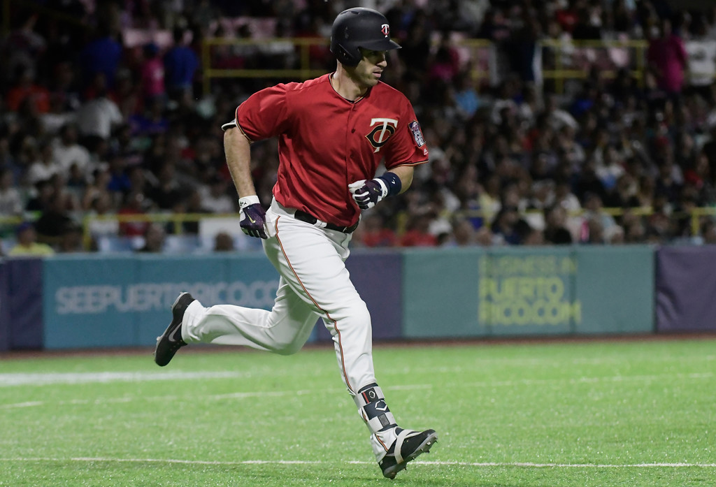 . Minnesota Twins infielder Joe Mauer runs to first during the first inning of game one of a two-game MLB Series against the Cincinnati Indians at Hiram Bithorn Stadium in San Juan, Puerto Rico, Tuesday, April 17, 2018. (AP Photo/Carlos Giusti)