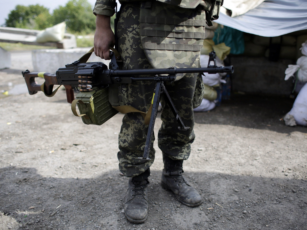 . A soldier holds a mashine-gun as he guards at a checkpoint controlled by Ukrainian forces on September 10, 2014, near the small eastern Ukrainian city of Slavyanoserbsk, in the Lugansk region. AFP PHOTO/ ANATOLII STEPANOVANATOLII STEPANOV/AFP/Getty Images