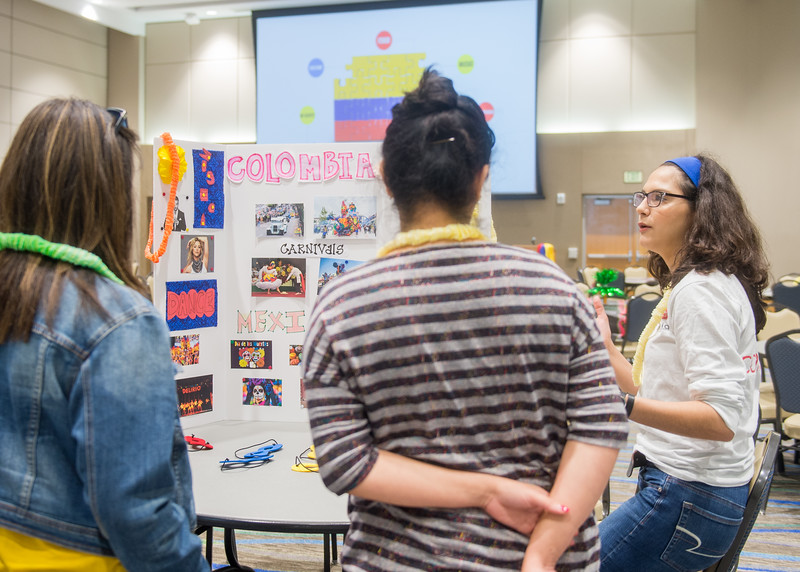 Itzel Solis (right) talks to students about the different cultural aspects of Colombia during the Help4Fun Colombian Student Association Fundraiser.