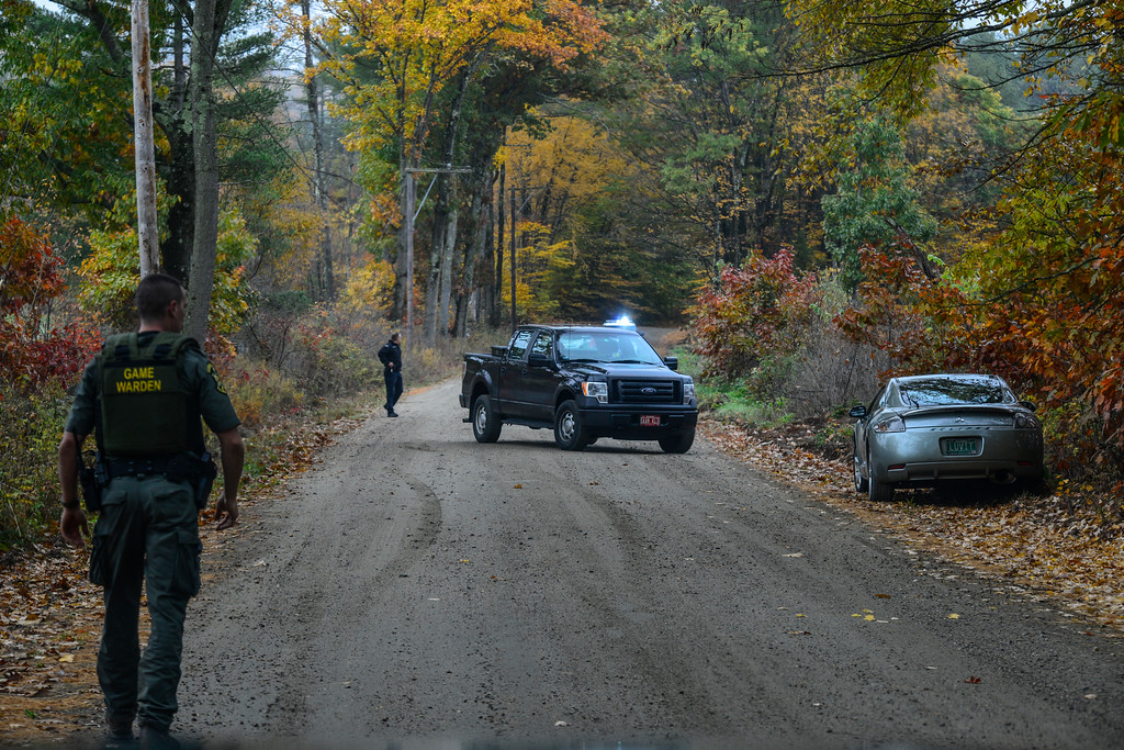 . Vermont State Police and various local police agencies investigate an abandoned Mitsubishi Eclipse on Plains Road in Weatherfield, Vt., on Tuesday, Oct. 18, 2016. Springfield Police responded to a armed robbery around 12:30p.m. at Windsor County South Credit Union on 383 River St. in Springfield. Police are actively searching for the suspect in connection to the bank robbery and motor vehicle theft.  Kristopher Radder / Reformer Staff