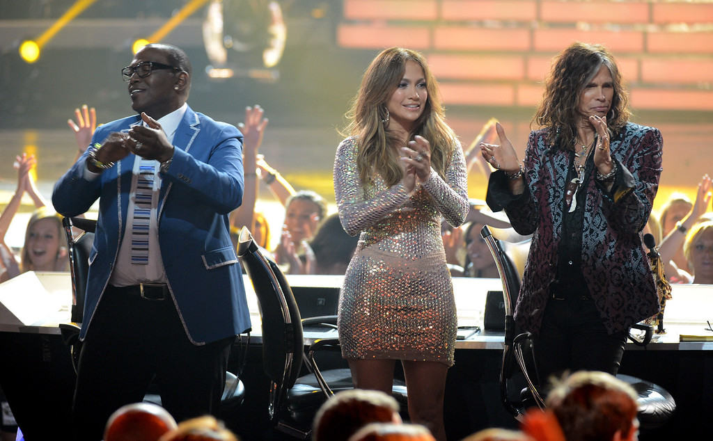 ". LOS ANGELES, CA - MAY 23:  Judges Randy Jackson, Jennifer Lopez, and Steven Tyler cheer onstage during Fox\'s ""American Idol 2012\"" results show at Nokia Theatre L.A. Live on May 23, 2012 in Los Angeles, California.  (Photo by Mark Davis/Getty Images)"