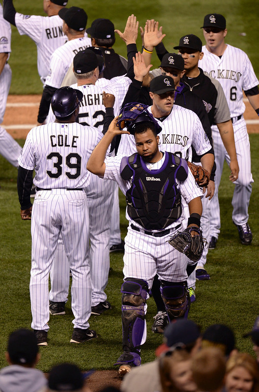 . DENVER, CO - APRIL 18: The Rockies celebrated the win Friday night. The Colorado Rockies defeated the Philadelphia Phillies 12-1 Friday night, April 18, 2014 at Coors Field.  (Photo by Karl Gehring/The Denver Post)