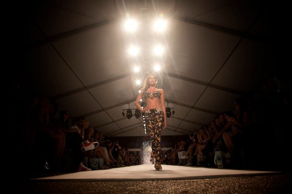. A model walks the runway during the Agua show at the Mercedes-Benz Fashion Week Swim show in Miami Beach, Fla., Friday, July 19, 2013. (AP Photo/J Pat Carter)