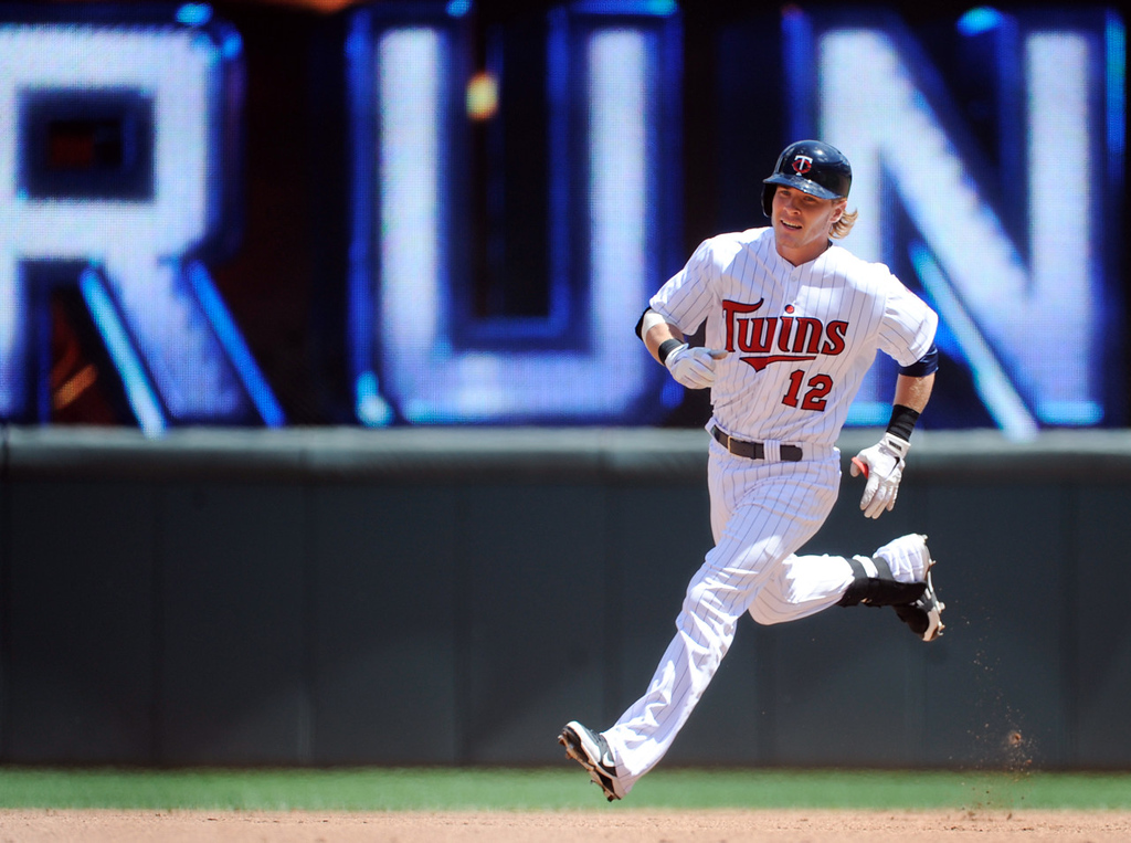 . Minnesota\'s Chris Herrmann rounds the bases after hitting a solo home run, his first of the season, against Mariners starter Jeremy Bonderman during the fourth inning. (AP Photo/Craig Lassig)