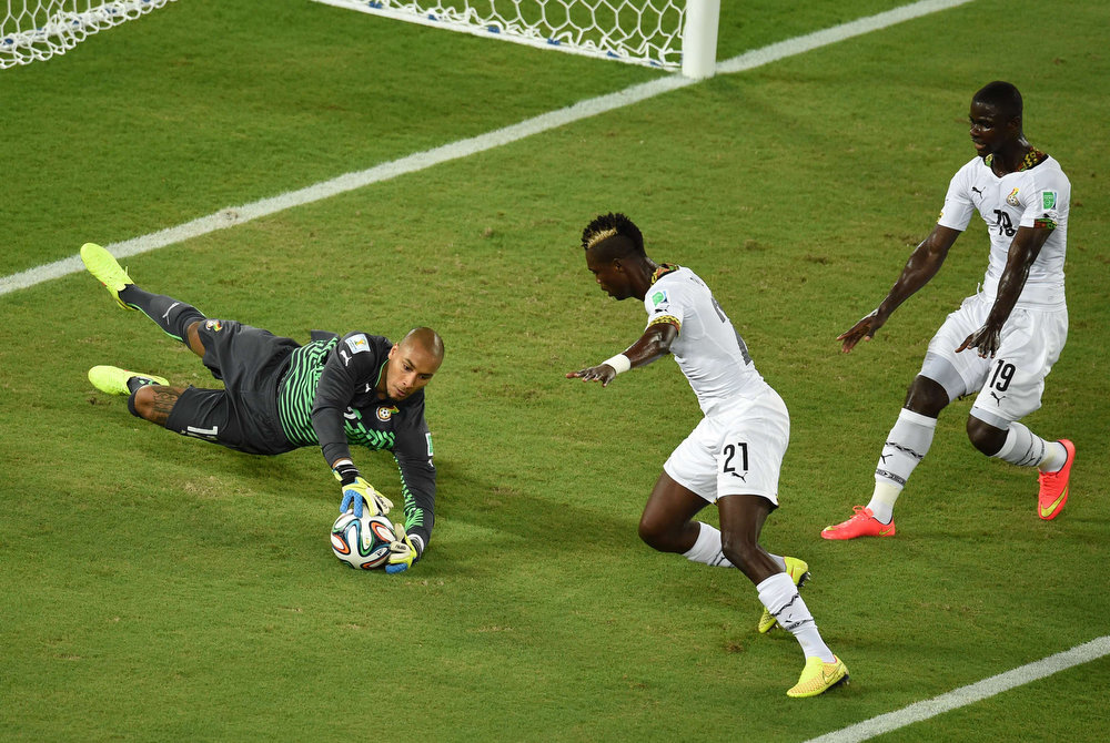 Description of . Ghana's goalkeeper Adam Larsen Kwarasey (L) dives for the ball during a Group G football match between Ghana and US at the Dunas Arena in Natal during the 2014 FIFA World Cup on June 16, 2014.   JAVIER SORIANO/AFP/Getty Images
