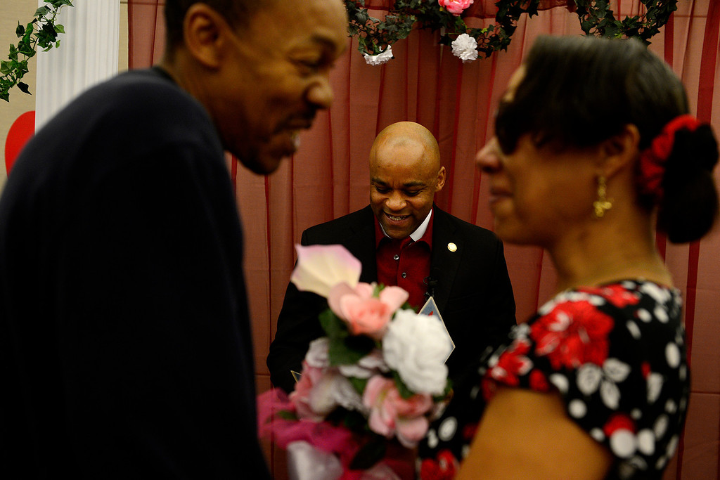 . DENVER, CO - FEBRUARY 14: Mayor Michael Hancock marries Delani Eugene Simmons and Lavette Michelle Noel during a Valentine\'s Day marriage celebration at the Denver Clerk and Recorder\'s office. Couples applying for marriage licenses received gift bags containing gift certificates to local restaurants among other treats to celebrate their union. (Photo By AAron Ontiveroz/The Denver Post)