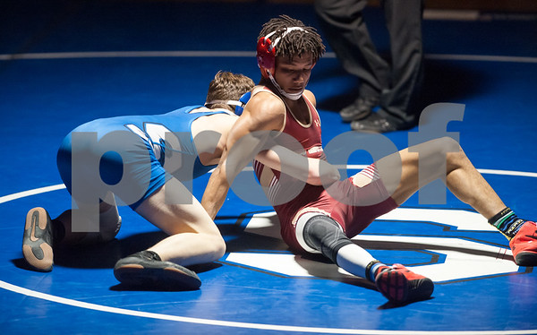 02/08/18 Wesley Bunnell   Staff Southington's Dawson Welch vs New Britain's Elijah Wattson in the 132lb class contest at Southington High School on Thursday night.