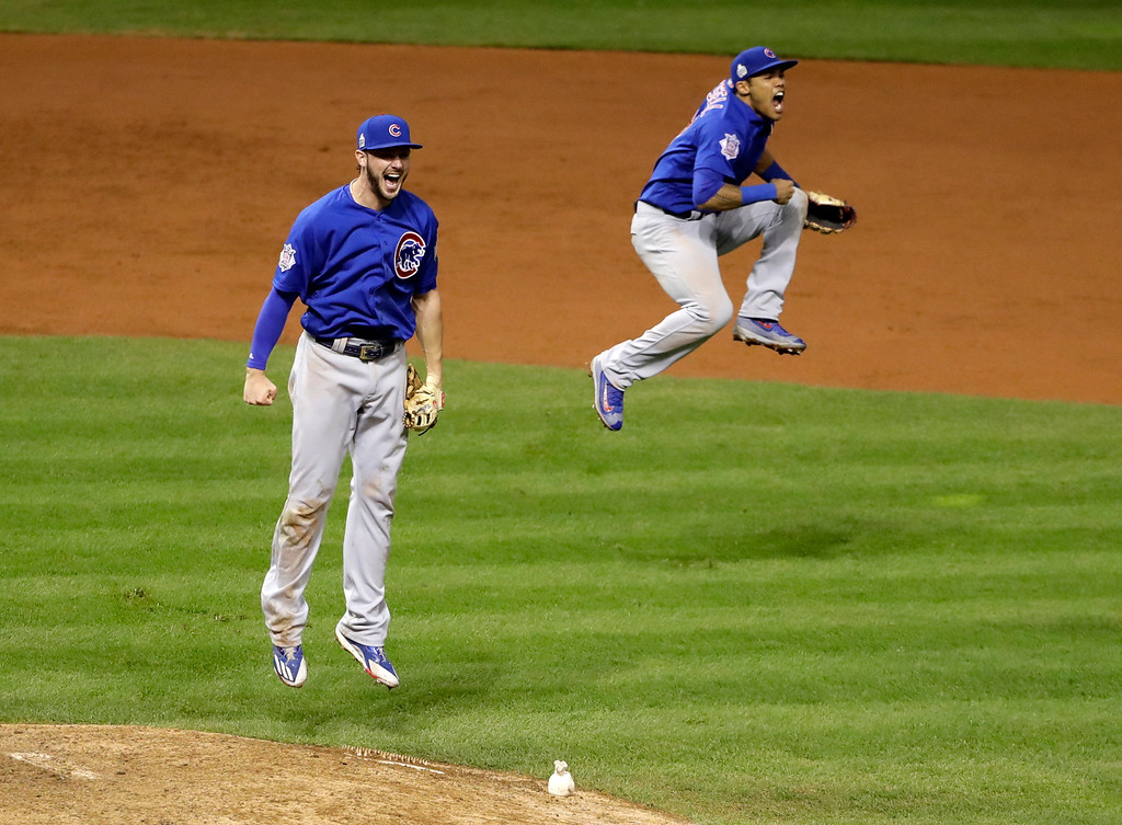 . Chicago Cubs\' Kris Bryant, left, and Addison Russell celebrate after Game 7 of the Major League Baseball World Series against the Cleveland Indians Thursday, Nov. 3, 2016, in Cleveland. The Cubs won 8-7 in 10 innings to win the series 4-3. (AP Photo/David J. Phillip)