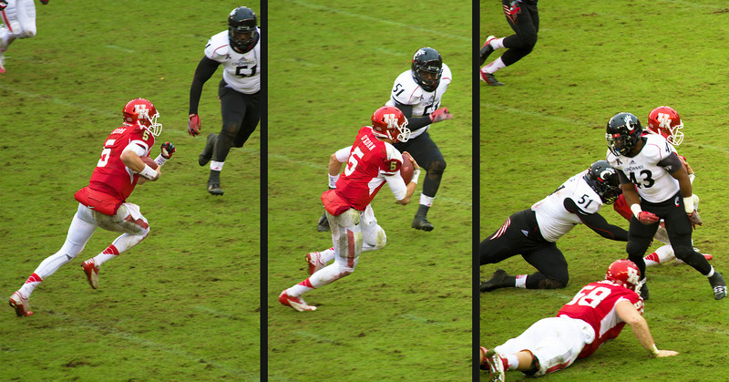 UH quarterback O'korn keeps the ball and runs.  .