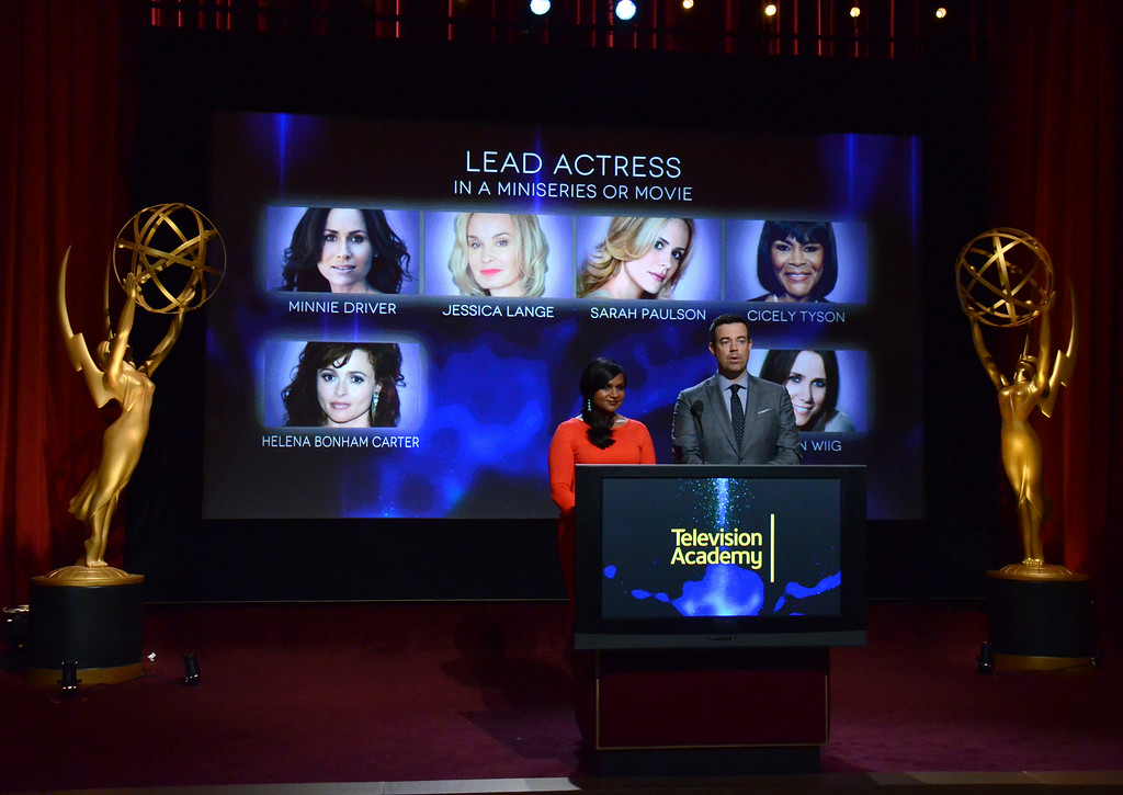 . Mindy Kaling, left, and Carson Daly announce the nominations for outstanding lead actress in a miniseries or movie at the 66th Primetime Emmy Awards nominations announcement at the Leonard H. Goldenson Theatre on Thursday, July 10, 2014, in Los Angeles. (Photo by Tonya Wise/Invision/AP)