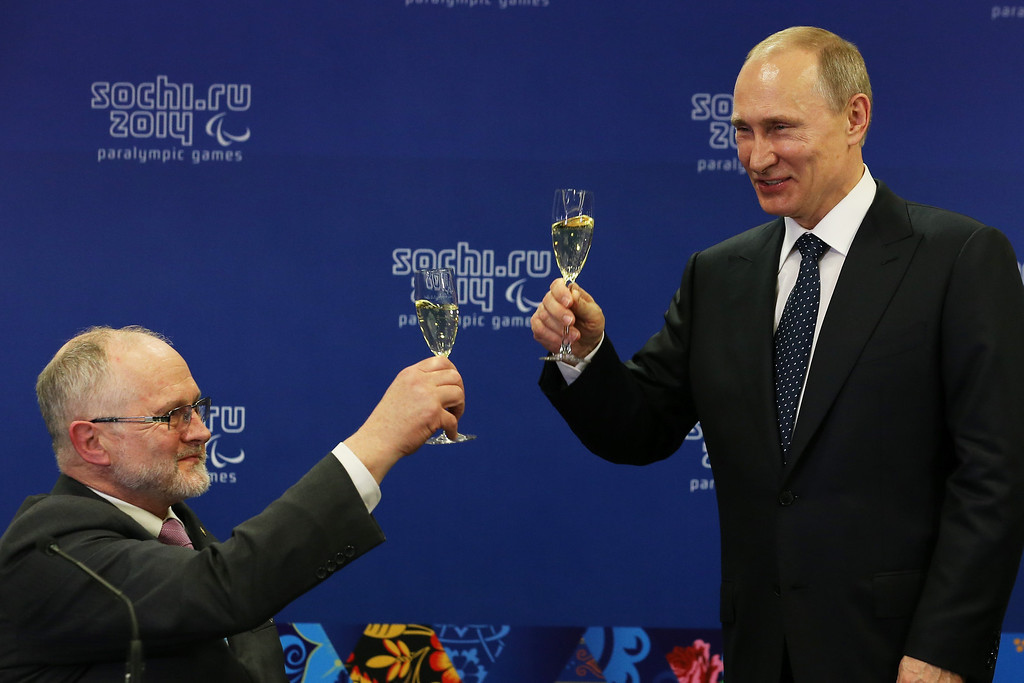 . (L-R) Sir Philip Craven the President of the International Paralympic Committee and Vladimir Putin the President of Russia perform a \'toast\' prior to the Opening Ceremony of the Sochi 2014 Paralympic Winter Games at Fisht Olympic Stadium on March 7, 2014 in Sochi, Russia.  (Photo by Ian Walton/Getty Images)