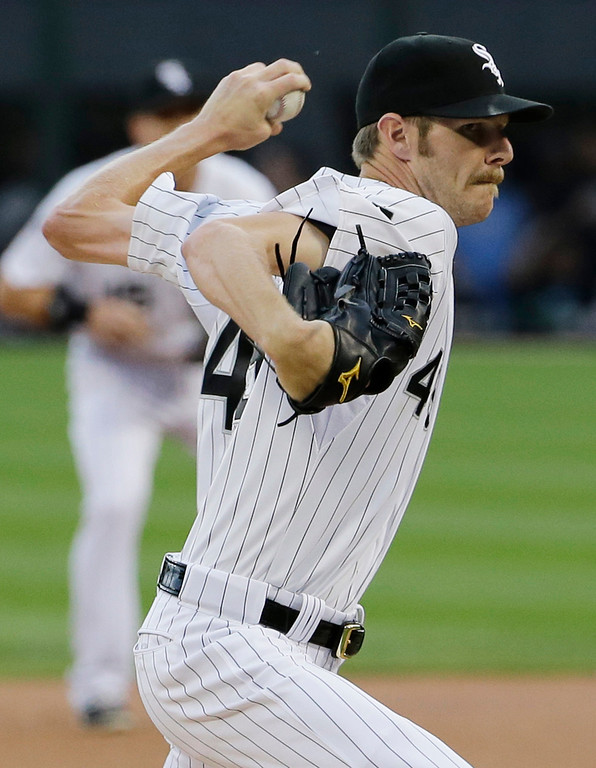 . Chicago White Sox starter Chris Sale throws against the Detroit Tigers during the first  inning of a baseball game in Chicago on Thursday, June 12, 2014. (AP Photo/Nam Y. Huh)