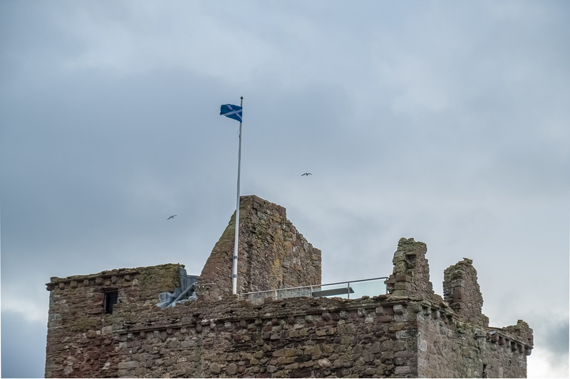 Scotlands Saltire Flag Flying High on Top of One of Scotlands Historic Castle Ruins the SNP's sign of Independance for Scotland
