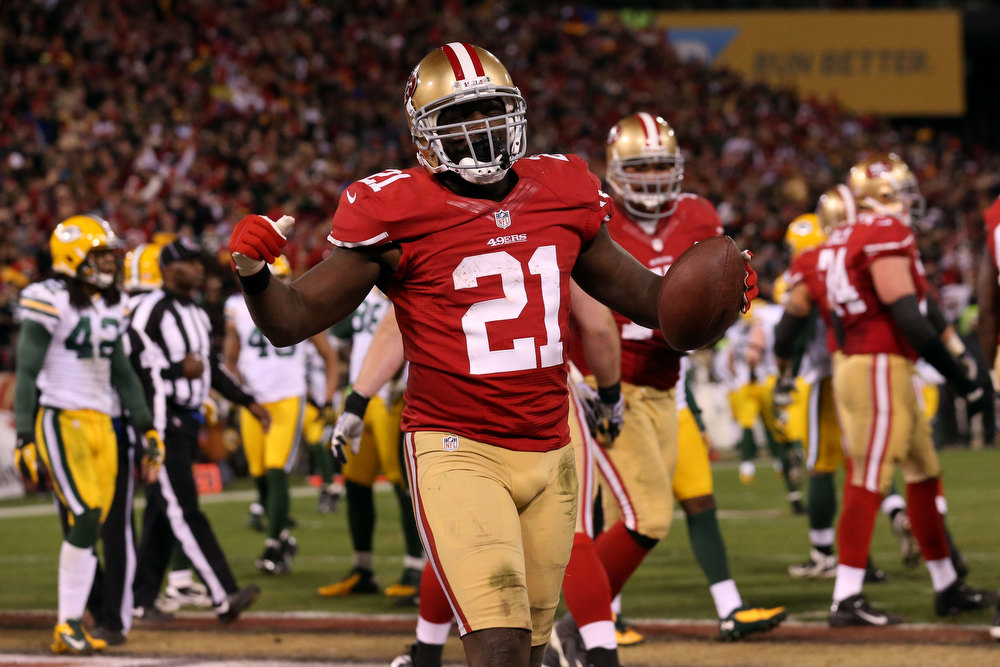 Description of . Running back Frank Gore #21 of the San Francisco 49ers celebrates after scoring a touchdown in the fourth quarter against the Green Bay Packers during the NFC Divisional Playoff Game at Candlestick Park on January 12, 2013 in San Francisco, California.  (Photo by Stephen Dunn/Getty Images)