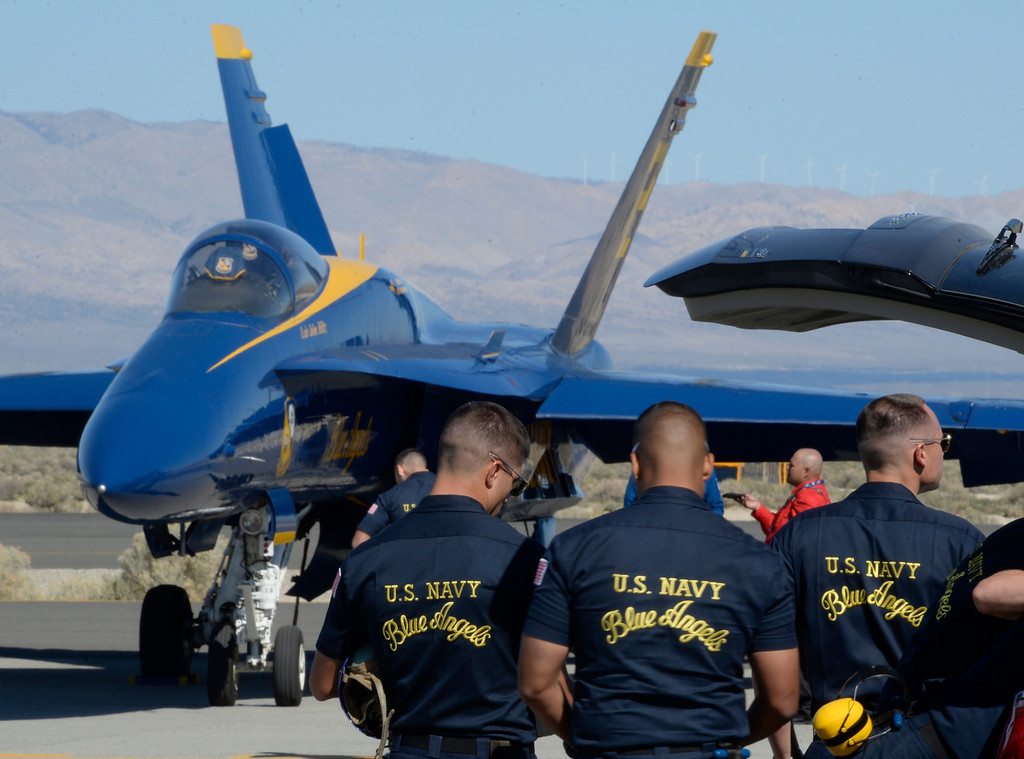 . March 19,2014. Lancaster CA.  Blue Angels crew members look over the jet planes as the Blue Angels arrive at Fox field Wednesday morning. The Los Angels County air show with the Blue Angels will happen this Friday and Saturday at Fox Field.  Photo   by Gene Blevins/LA DailyNews