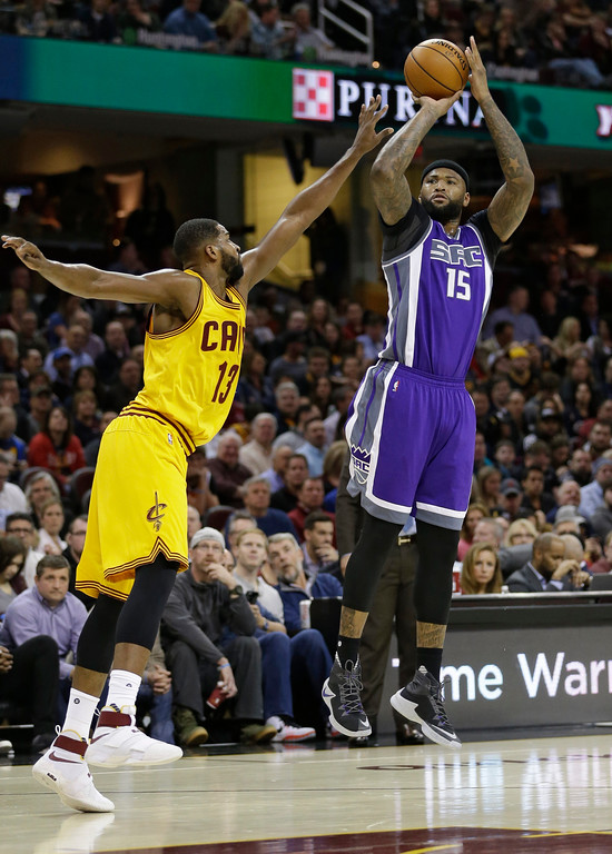 . Sacramento Kings\' DeMarcus Cousins (15) shoots over Cleveland Cavaliers\' Tristan Thompson (13) in the first half of an NBA basketball game, Wednesday, Jan. 25, 2017, in Cleveland. (AP Photo/Tony Dejak)