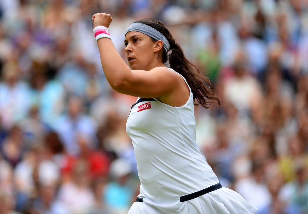 . LONDON, ENGLAND - JULY 04:  Marion Bartoli of France celebrates a point during the Ladies� Singles semi final match against Kirsten Flipkens of Belgium on day ten of the Wimbledon Lawn Tennis Championships at the All England Lawn Tennis and Croquet Club on July 4, 2013 in London, England.  (Photo by Mike Hewitt/Getty Images)