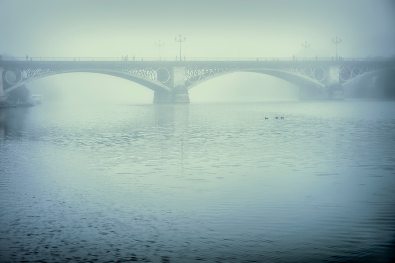Triana bridge on a misty day, Seville, Spain.